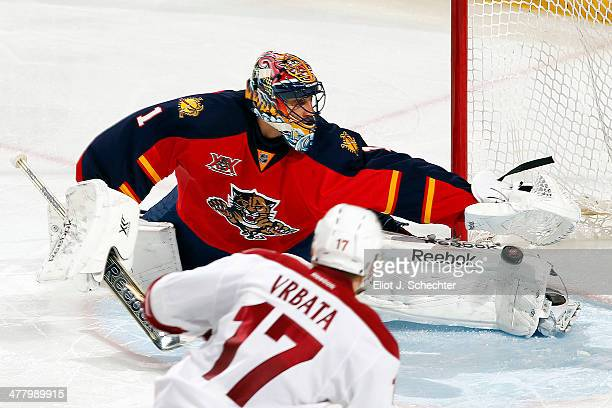 Radim Vrbata of the Phoenix Coyotes shoots and scores a goal against goaltender Roberto Luongo of the Florida Panthers at the BBT Center on March 11...