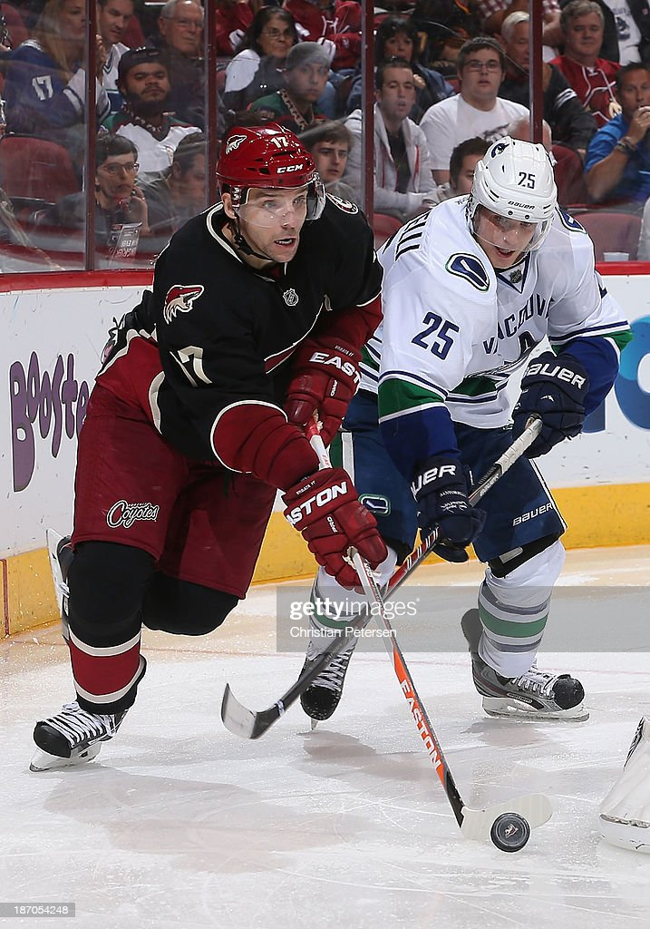<a gi-track='captionPersonalityLinkClicked' href=/galleries/search?phrase=Radim+Vrbata&family=editorial&specificpeople=204716 ng-click='$event.stopPropagation()'>Radim Vrbata</a> #17 of the Phoenix Coyotes skates with the puck ahead of <a gi-track='captionPersonalityLinkClicked' href=/galleries/search?phrase=Mike+Santorelli&family=editorial&specificpeople=4517042 ng-click='$event.stopPropagation()'>Mike Santorelli</a> #25 of the Vancouver Canucks during the NHL game at Jobing.com Arena on November 5, 2013 in Glendale, Arizona. The Coyotes defeated the Canucks 3-2 in an overtime shoot out.