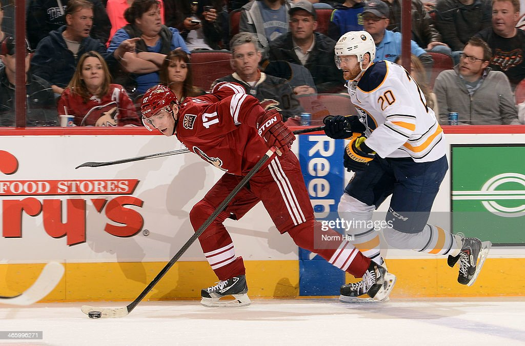 <a gi-track='captionPersonalityLinkClicked' href=/galleries/search?phrase=Radim+Vrbata&family=editorial&specificpeople=204716 ng-click='$event.stopPropagation()'>Radim Vrbata</a> #17 of the Phoenix Coyotes skates with the puck ahead of Henrik Talllinder #20 of the Buffalo Sabres during the first period at Jobing.com Arena on January 30, 2014 in Glendale, Arizona. The game was Vrbata's 400th career game.