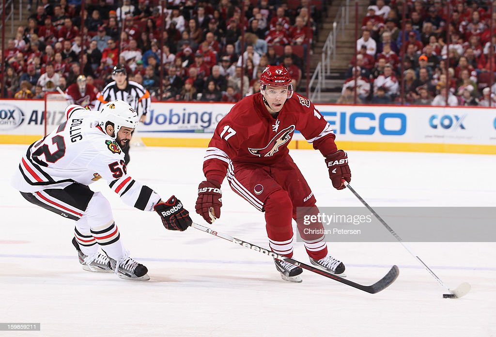 <a gi-track='captionPersonalityLinkClicked' href=/galleries/search?phrase=Radim+Vrbata&family=editorial&specificpeople=204716 ng-click='$event.stopPropagation()'>Radim Vrbata</a> #17 of the Phoenix Coyotes skates with the puck past Brandon Bollig #52 of the Chicago Blackhawks during the NHL game at Jobing.com Arena on January 20, 2013 in Glendale, Arizona. The Blackhawks defeated the Coyotes 6-4.