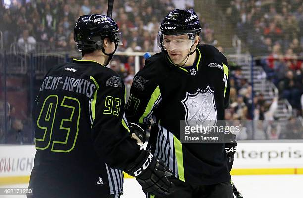 Radim Vrbata of the Vancouver Canucks and Team Foligno celebrates after scoring a goal in the first period against Roberto Luongo of the Florida...