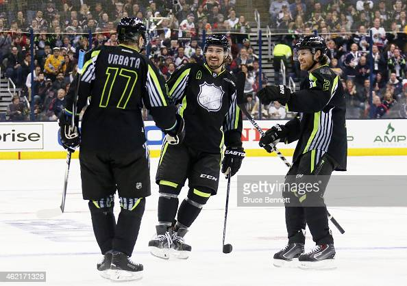 Radim Vrbata of the Vancouver Canucks and Team Foligno celebrates with Drew Doughty of the Los Angeles Kings after scoring a goal in the first period...