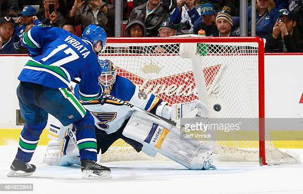 Radim Vrbata of the Vancouver Canucks beats Jake Allen of the St Louis Blues for a shootout goal during their NHL game at Rogers Arena March 1 2015...