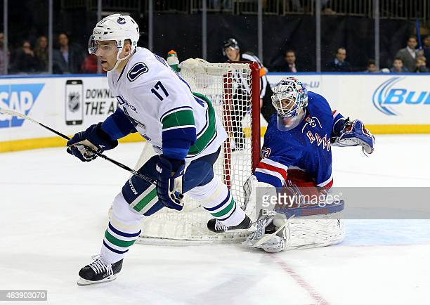 Radim Vrbata of the Vancouver Canucks scores the game winner as Cam Talbot of the New York Rangers looks on during the shootout on February 19 2015...