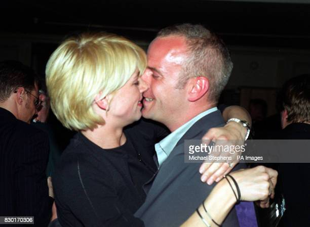 Radio 1 breakfast disc jockey Zoe Ball embraces her fiance Norman Cook aka DJ Fatboy Slim at a ceremony at the Grosvenor House Hotel in London where...