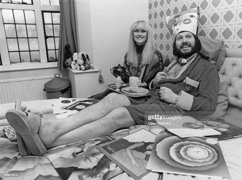 BBC Radio 1 presenter <a gi-track='captionPersonalityLinkClicked' href=/galleries/search?phrase=Dave+Lee+Travis&family=editorial&specificpeople=1624287 ng-click='$event.stopPropagation()'>Dave Lee Travis</a> presents his breakfast show from his bed at home in Ealing, London, 22nd December 1978. With him is his wife Marianne.
