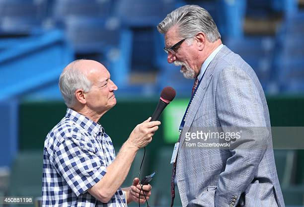 Radio announcer Jerry Howarth interviews former player Jack Morris during batting practice before the start of the Toronto Blue Jays MLB game against...