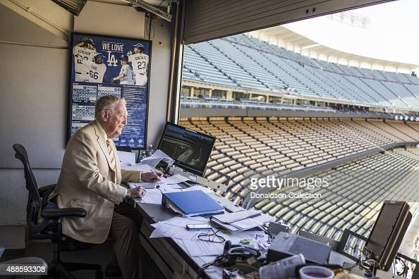 Radio announcer Vin Scully poses for a poses for a portrait in his studio booth on July 29 2015 at Dodger Stadium in Los Angeles California