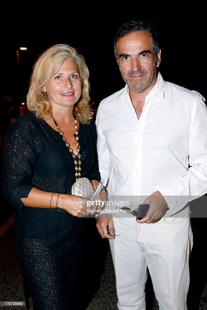 Radio Christopher Baldelli (R) and his wife Evelyne Baldelli attend Magician Eric Antoine's show, 'Le mix sous les etoiles' on day 7 of the 29th Ramatuelle Festival on August 6, 2013 in Ramatuelle, France.