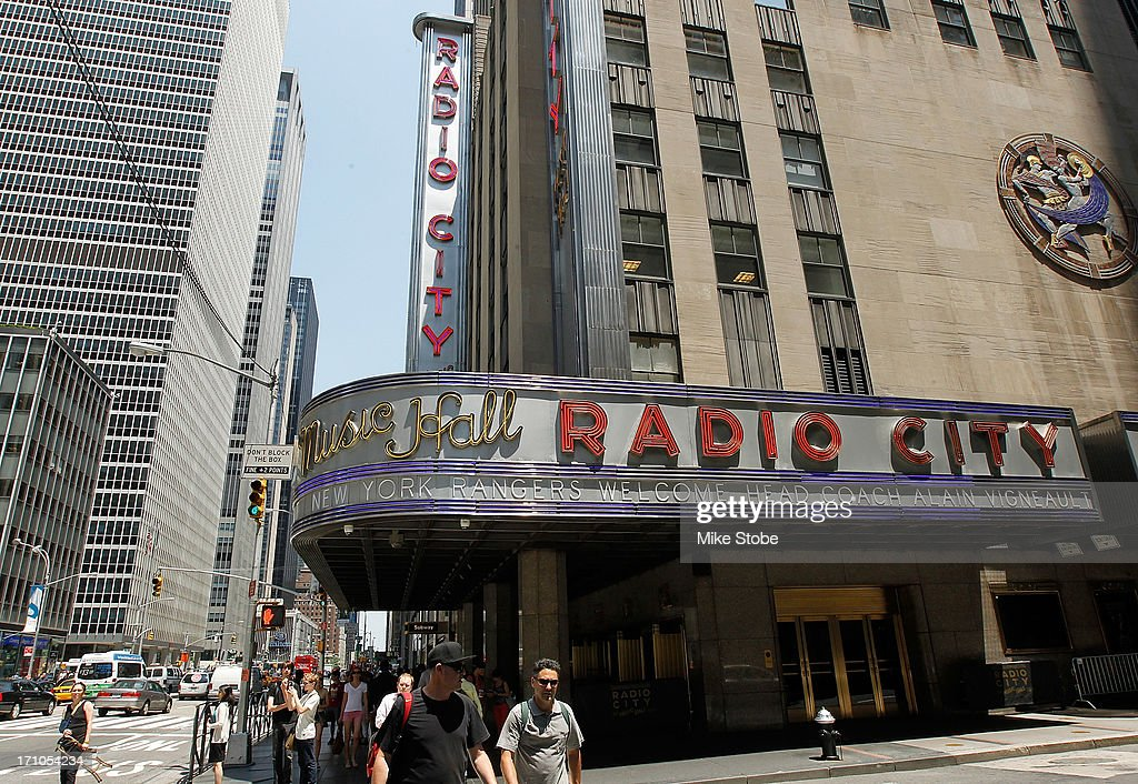 Radio City Music Hall marquee displays a message welcoming new head coach <a gi-track='captionPersonalityLinkClicked' href=/galleries/search?phrase=Alain+Vigneault&family=editorial&specificpeople=4146583 ng-click='$event.stopPropagation()'>Alain Vigneault</a> during a press conference at Radio City Music Hall on June 21, 2013 in New York City.