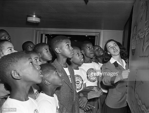 Children contest winners from the AfroAmeric Newspapers and NBC Guest Tour Guide during a studio tour on August 2 1946 Photo by NBC/NBCU Photo Bank