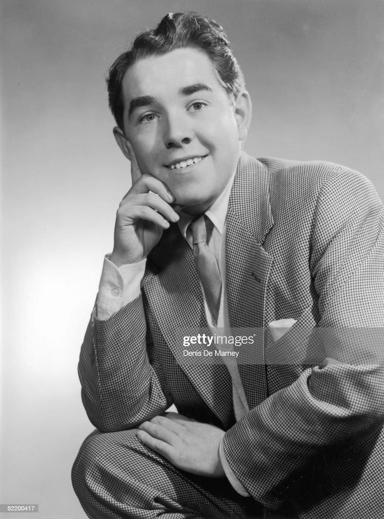Radio comedian Ronnie Corbett posing with his finger on his cheek circa 1955