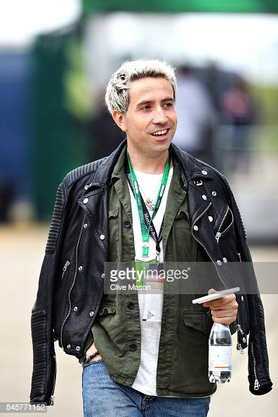Radio DJ and TV personality Nick Grimshaw walks in the Paddock before the Formula One Grand Prix of Great Britain at Silverstone on July 10 2016 in...