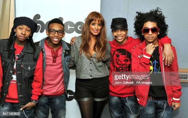 Radio DJ Max stands with Ray Ray Prodigy Roc Royal and Princeton singers of the new American pop band Mindless Behavior during a live performance in...