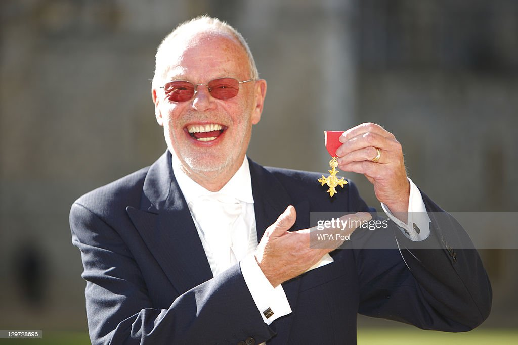 Radio DJ 'Whispering' Bob Harris poses after receiving his Officer of the British Empire (OBE) from the Princess Anne, Princess Royal at Windsor Castle on October 20, 2011 in Windsor, England.