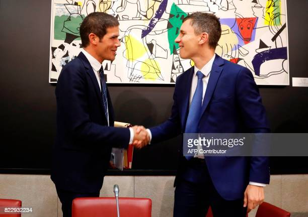 Radio France President Mathieu Gallet shakes hands with President of the Commission of cultural affaires Bruno Studer upon his arrival at the French...