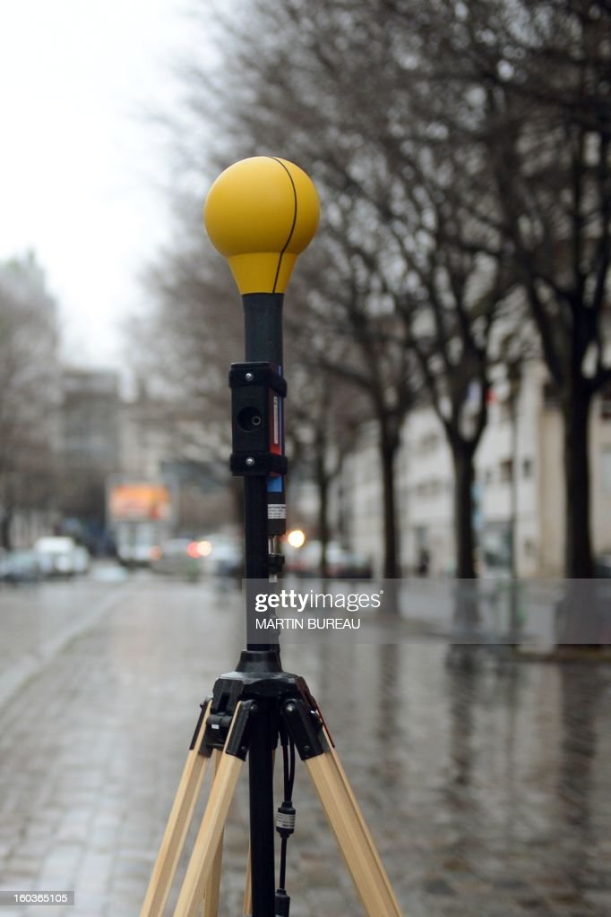 Radio frequency emission and electromagnetic field measuring and testing equipment is set up near a mobile telephone base station antenna, on January 30, 2013 in Paris. AFP PHOTO MARTIN BUREAU