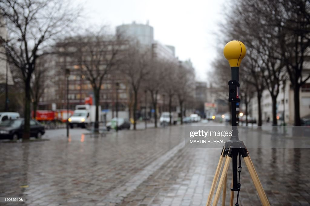 Radio frequency emission and electromagnetic field measuring and testing equipment is set up near a mobile telephone base station antenna, on January 30, 2013 in Paris.