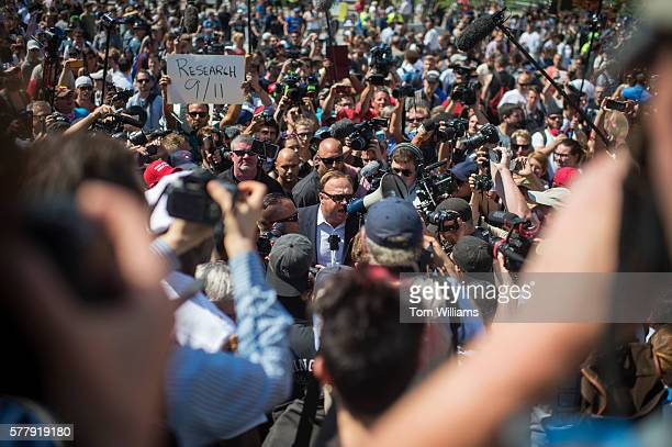 Radio host Alex Jones attends a rally before being escorted out in the Public Square near the Republican National Convention at the Quicken Loans...