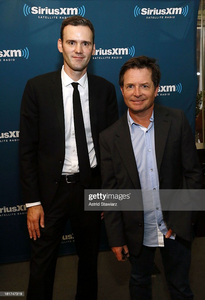 EW Radio host Dalton Ross and actor <a gi-track='captionPersonalityLinkClicked' href=/galleries/search?phrase=Michael+J.+Fox&family=editorial&specificpeople=208846 ng-click='$event.stopPropagation()'>Michael J. Fox</a> pose at SiriusXM's 'Town Hall' series at SiriusXM Studios on September 24, 2013 in New York City.
