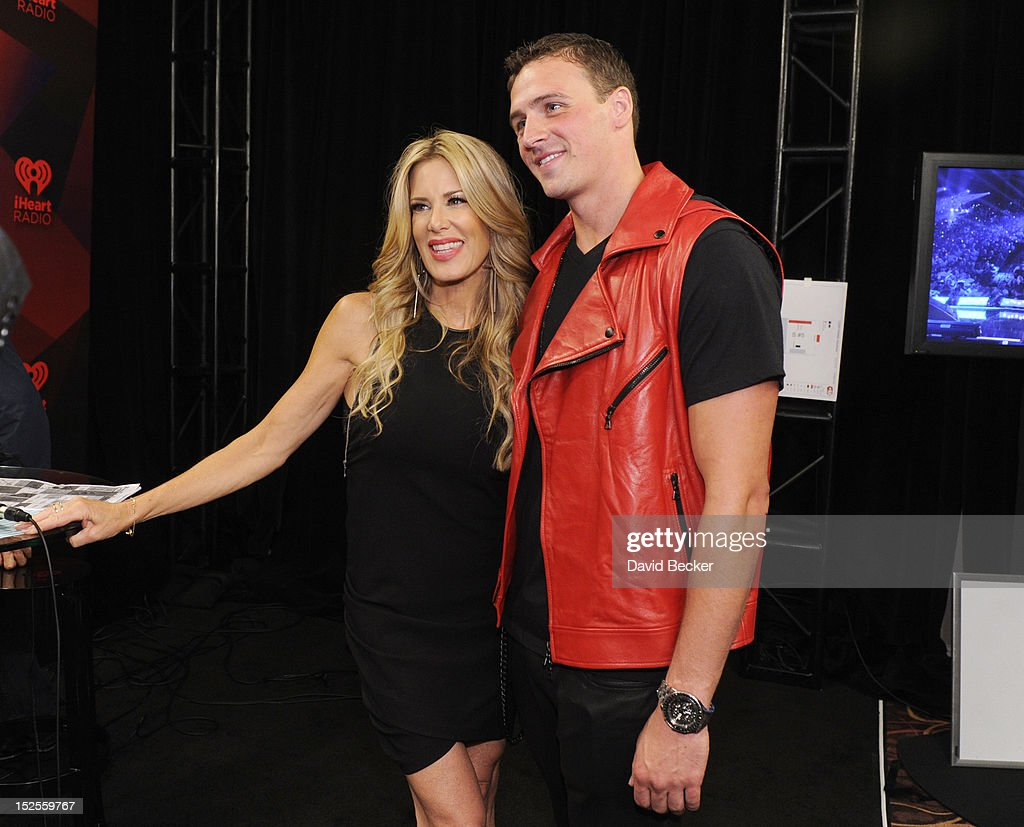Radio host Ellen K and U.S. Olympian Ryan Lochte pose in the Elvis Duran Broadcast Room during the 2012 iHeartRadio Music Festival at the MGM Grand Garden Arena on September 21, 2012 in Las Vegas, Nevada.