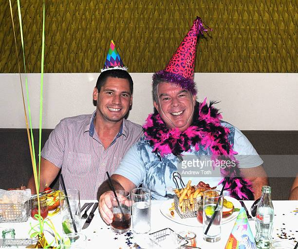 Radio host Elvis Duran and Alex Carr attend Elvis Duran's Birthday Lunch at David Burke Kitchen at the James Hotel on July 28 2014 in New York City
