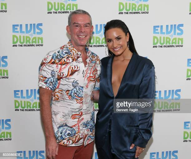 Radio host Elvis Duran and recording artist Demi Lovato pose for a picture during the 'The Elvis Duran Z100 Morning Show' at Z100 Studio on August 17...