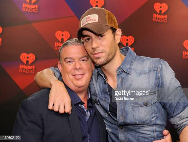 Radio host Elvis Duran and singer Enrique Iglesias pose in the Elvis Duran Broadcast Room during the 2012 iHeartRadio Music Festival at the MGM Grand...