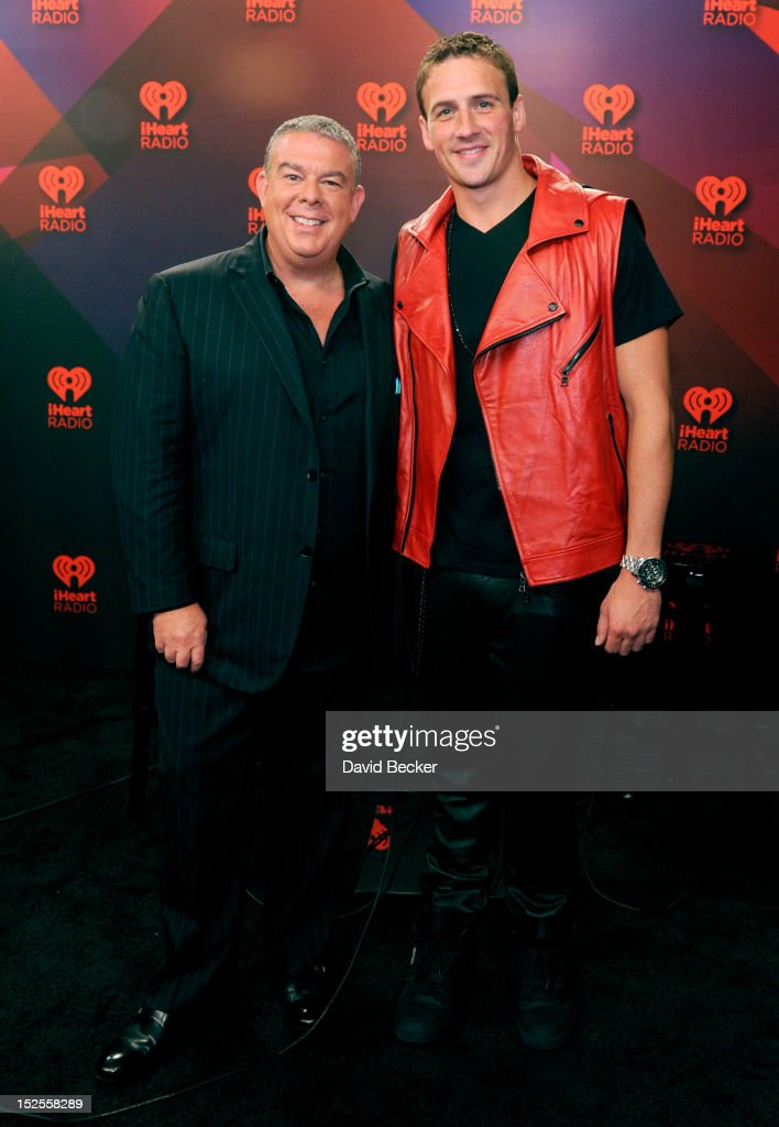Radio host Elvis Duran and U.S. Olympian Ryan Lochte pose in the Elvis Duran Broadcast Room during the 2012 iHeartRadio Music Festival at the MGM Grand Garden Arena on September 21, 2012 in Las Vegas, Nevada.