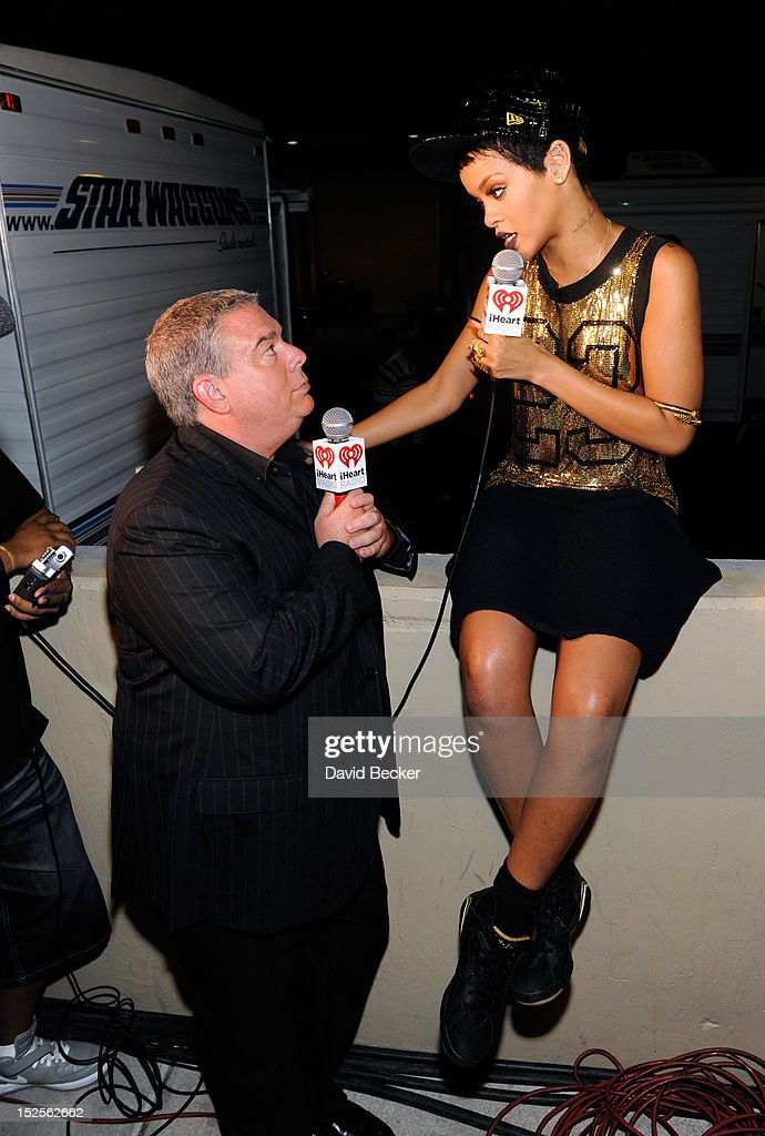 Radio host <a gi-track='captionPersonalityLinkClicked' href=/galleries/search?phrase=Elvis+Duran&family=editorial&specificpeople=3048281 ng-click='$event.stopPropagation()'>Elvis Duran</a> interviews singer <a gi-track='captionPersonalityLinkClicked' href=/galleries/search?phrase=Rihanna&family=editorial&specificpeople=453439 ng-click='$event.stopPropagation()'>Rihanna</a> in the <a gi-track='captionPersonalityLinkClicked' href=/galleries/search?phrase=Elvis+Duran&family=editorial&specificpeople=3048281 ng-click='$event.stopPropagation()'>Elvis Duran</a> Broadcast Room during the 2012 iHeartRadio Music Festival at the MGM Grand Garden Arena on September 21, 2012 in Las Vegas, Nevada.