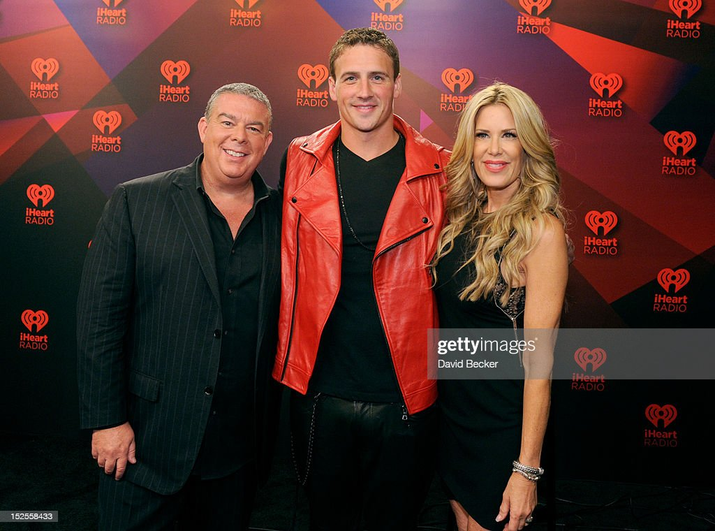 Radio host Elvis Duran, U.S. Olympian Ryan Lochte and radio host Ellen K pose in the Elvis Duran Broadcast Room during the 2012 iHeartRadio Music Festival at the MGM Grand Garden Arena on September 21, 2012 in Las Vegas, Nevada.