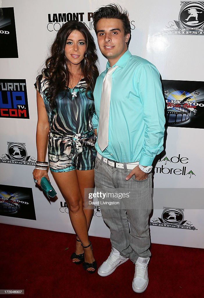 Radio host Jennifer Tapiero (L) and singer Sam Stone attend the 'Party After' BET Awards 2013 hosted by Chris Brown and Nick Cannon at the Belasco Theater on June 30, 2013 in Los Angeles, California.