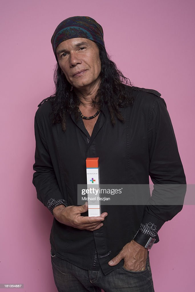 Radio host 'Native' Wayne Jobson poses with 'Skin Again' at the Mark Kearney Group 'Iced Out' Luxury Emmy Suite on September 19, 2013 in Los Angeles, California.