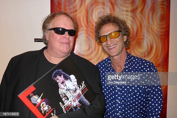 Radio host Tom Leykis and photographer Jim Steinfeldt pose for a portrait with Steinfeldt's book Rock 'N' Roll Lens at the Mike Walker book signing...