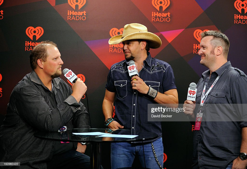 Radio hosts Big D and Bubba interview singer <a gi-track='captionPersonalityLinkClicked' href=/galleries/search?phrase=Jason+Aldean&family=editorial&specificpeople=619221 ng-click='$event.stopPropagation()'>Jason Aldean</a> in the Elvis Duran Broadcast Room during the 2012 iHeartRadio Music Festival at the MGM Grand Garden Arena on September 21, 2012 in Las Vegas, Nevada.