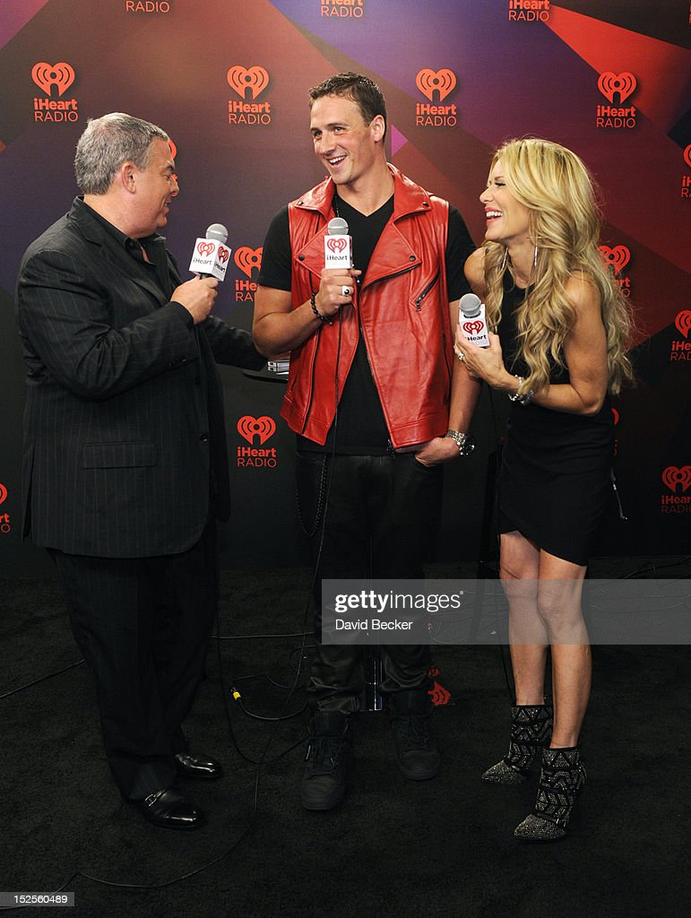 Radio hosts Elvis Duran and Ellen K interview U.S. Olympian Ryan Lochte in the Elvis Duran Broadcast Room during the 2012 iHeartRadio Music Festival at the MGM Grand Garden Arena on September 21, 2012 in Las Vegas, Nevada.