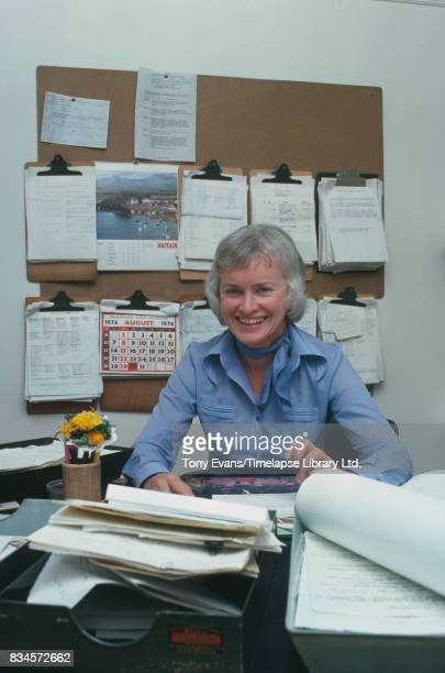 Radio journalist and BBC's 'Woman's Hour' editor Wyn Knowles sitting at her desk August 1976