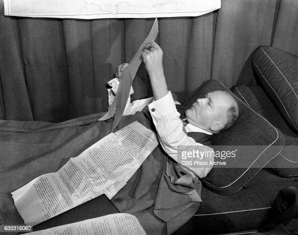 Radio news commentator and analyst HV Kaltenborn resting in his office in between reports of the developing European War crisis New York NY Image...