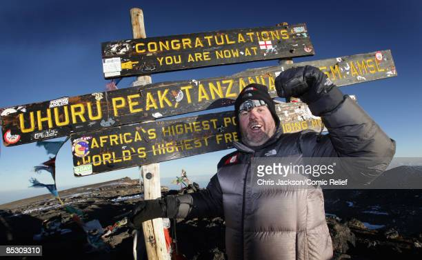 Radio One DJ Chris Moyles laughs as he reaches the top of Mount Kilimanjaro on the seventh day of The BT Red Nose Climb of Kilimanjaro on March 7...