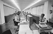 Radio operators in an office at The New Scotland Yard building on Broadway London 16th February 1967 shortly after the headquarters of the...