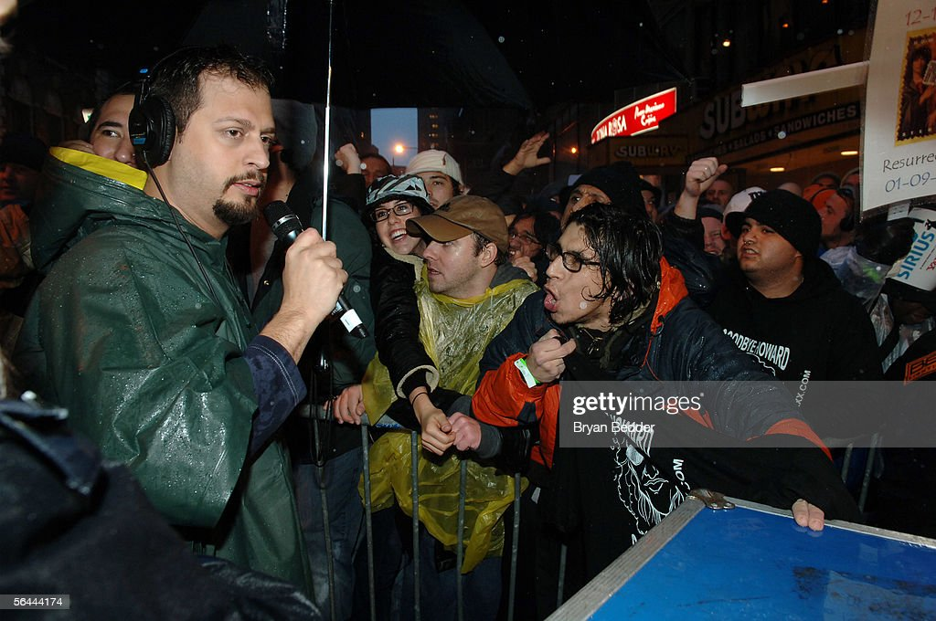 Radio Peronality Salvatore 'Sal The Stockbroker' Governale (L) talks with fans during his last WXRK 'Howard Stern Show' December 16, 2005 in New York City.