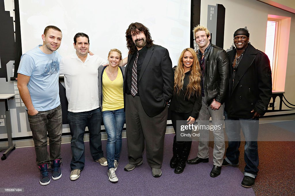 Z100 radio personalities Garrett, Skeery Jones, and Carla Marie pose with WWE legend Mick Foley, WWE Diva Layla El, and WWE Superstars Zack Ryder and R-Truth during a visit to St. Mary's Hospital For Children on April 3, 2013 in New York City.