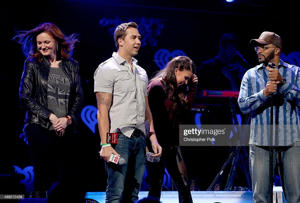 Radio personalities Kellie Rasberry, J-Si Chavez, Jenna Owens and Big Al Mack speak onstage during 106.1 KISS FM's Jingle Ball 2013 at American Airlines Center on December 2, 2013 in Dallas, Texas.