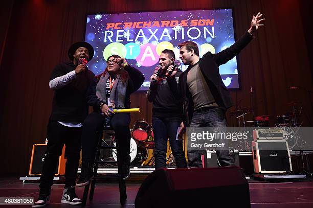 Radio personalities Maxwell Mo' Bounce and Phill Kross appear with a fan onstage at Z100 CocaCola All Access Lounge at Z100's Jingle Ball 2014...