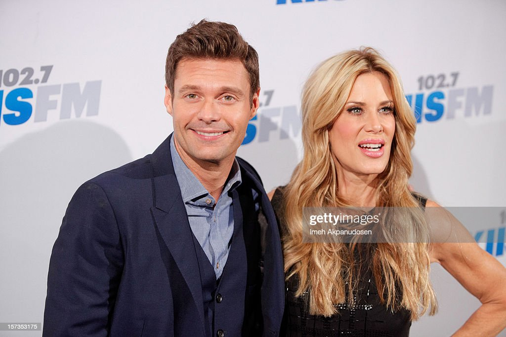 Radio personalities Ryan Seacrest (L) and Ellen K attend KIIS FM's 2012 Jingle Ball at Nokia Theatre L.A. Live on December 1, 2012 in Los Angeles, California.
