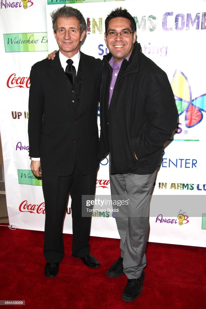Radio personality Aaron Sanchez (R) and producer Sir Richard Winter-Stanbridge attend the 'Up In Arms' comedy fundraiser benefiting Children's Hospital Los Angeles held at Park La Brea Theater on December 8, 2013 in Los Angeles, California.