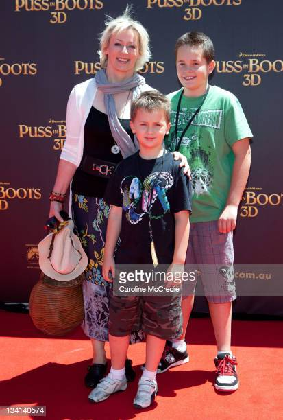 Radio personality Amanda Keller and sons Jack and Liam arrive at the 'Puss in Boots' Australian Premiere at HOYTS Entertainment Quarter on November...