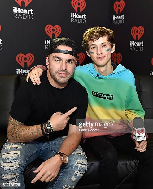 Radio personality Billy The Kidd and recording artist/actor Troye Sivan attend the 2016 Daytime Village at the iHeartRadio Music Festival at the Las...