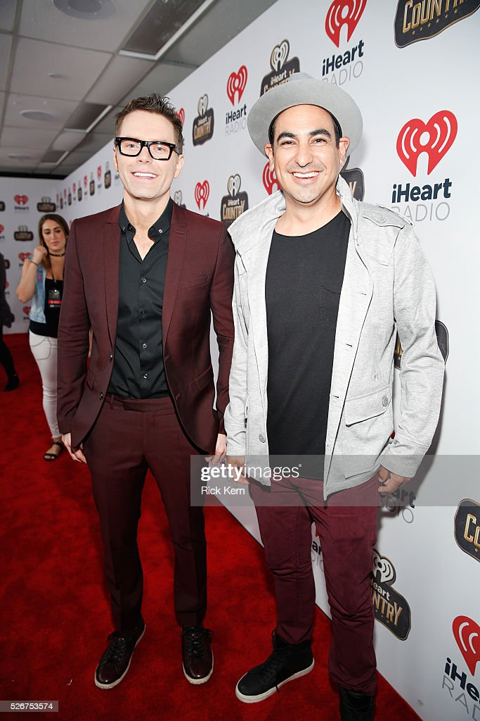 Radio personality Bobby Bones (L) and producer Eddie Garcia attend the 2016 iHeartCountry Festival at The Frank Erwin Center on April 30, 2016 in Austin, Texas.