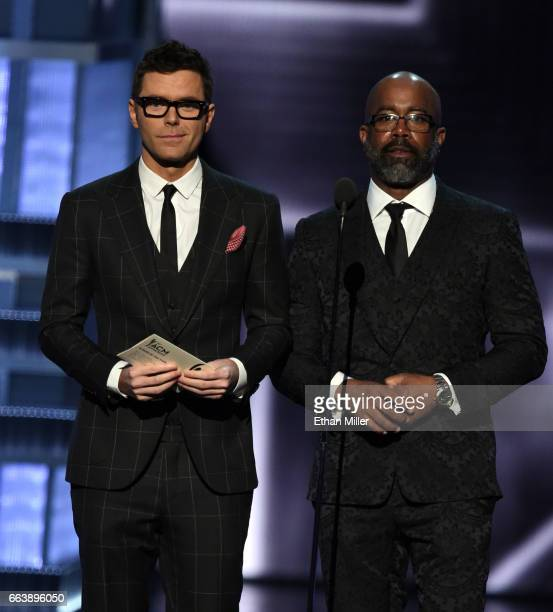 Radio personality Bobby Bones and recording artist Darius Rucker speak onstage during the 52nd Academy of Country Music Awards at TMobile Arena on...